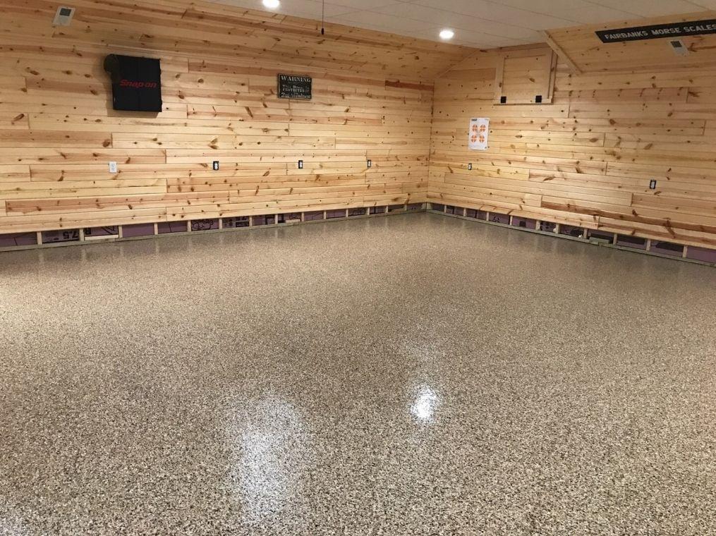Modern basement with flake flooring.