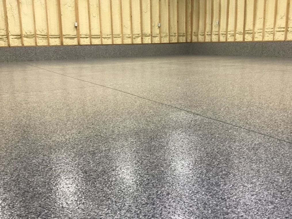 An up close look at granite flooring installed on a local garage.