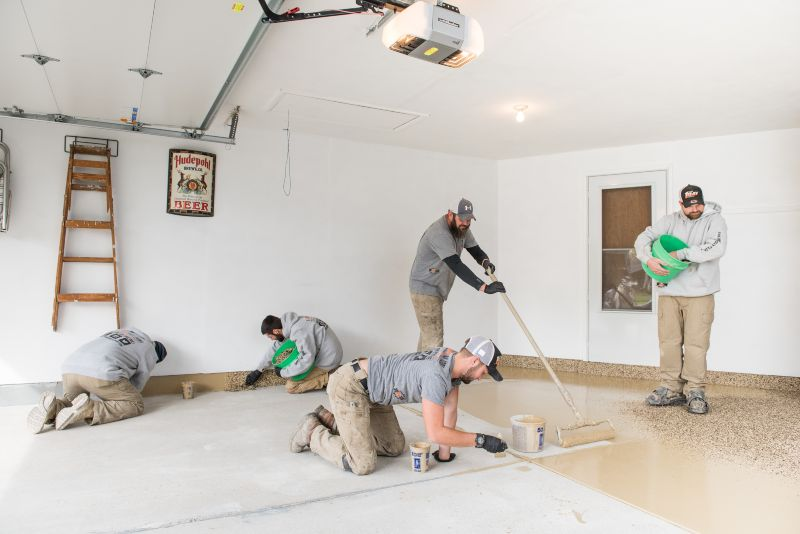 Our team installing your 1 day flake flooring.