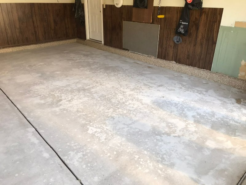 Before a garage floor installed with pecan colored flakes.