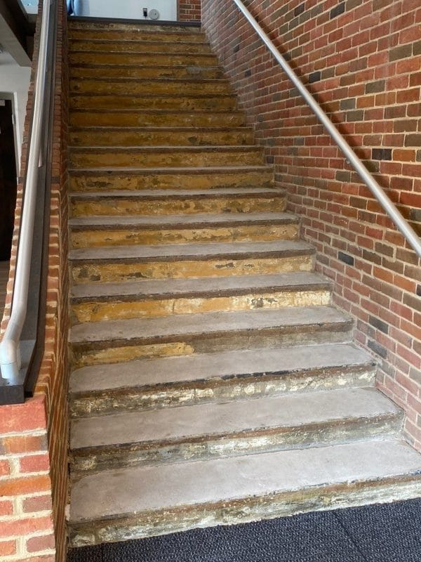 Before custom flooring was installed on a stairwell.