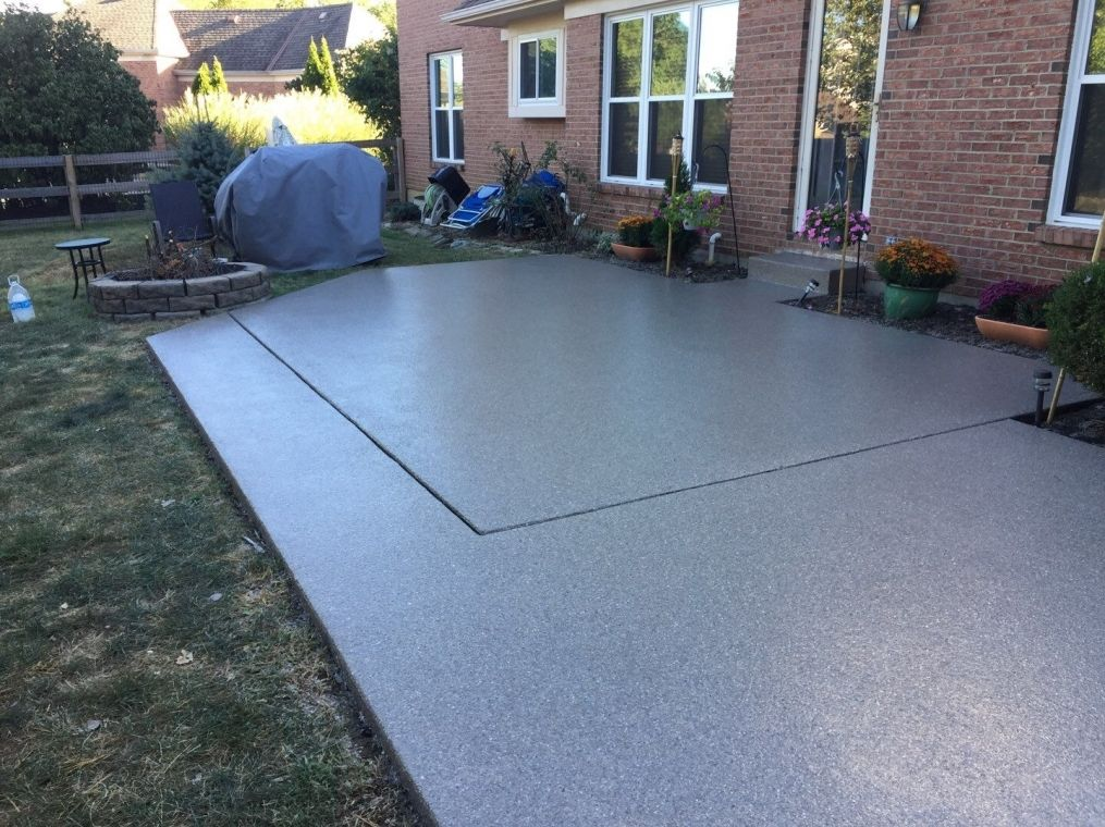 A freshly sealed outdoor patio with flake polyurea flooring.