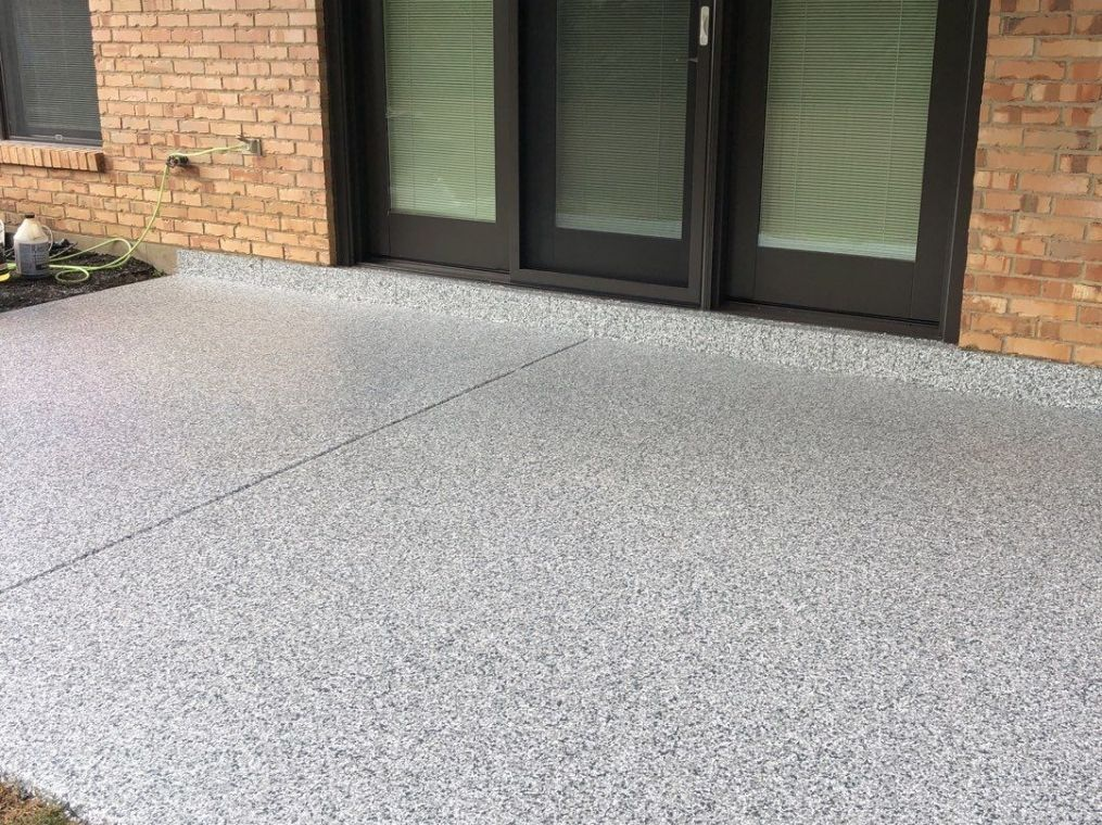 After photo of a patio with custom flake flooring installed.