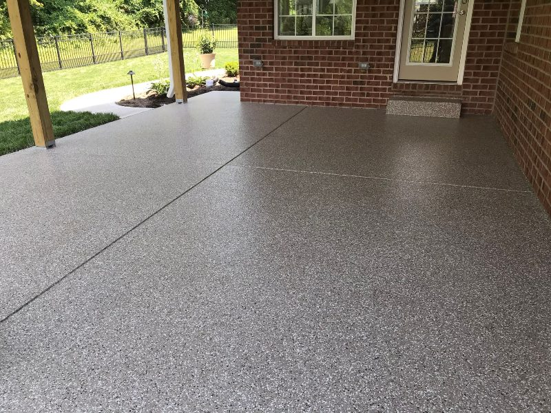 Making patios look amazing. After pebble beach flake flooring installed.