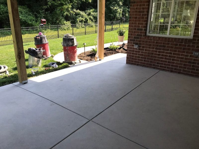 Making patios look amazing. Before pebble beach flake flooring installed.
