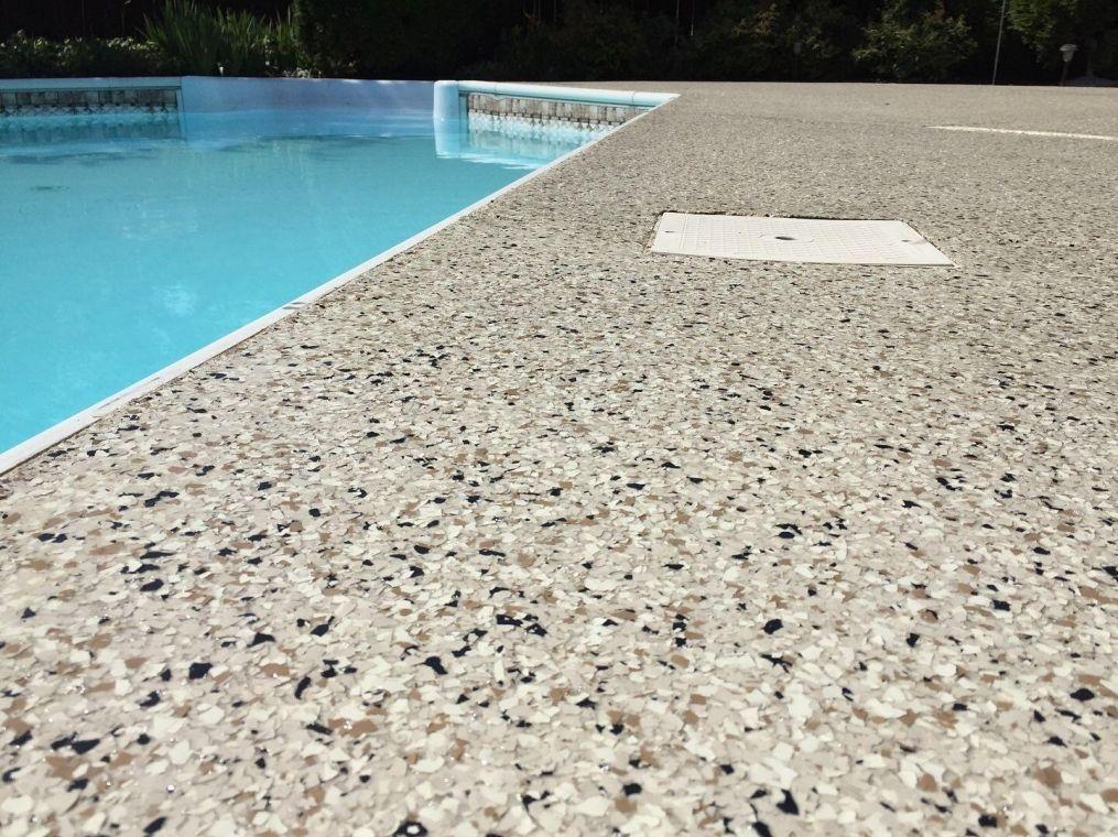 Granite look poolside flake flooring.