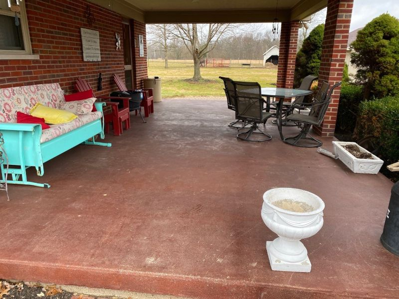 Before patio flake flooring installation.